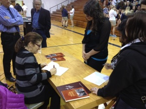 Julie held a book signing  for the students and teachers following the program.